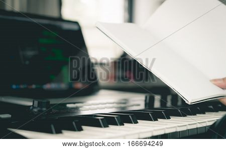 Musician is holding a blank book for song writting