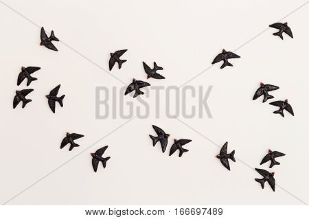 Bird Figurines on a Bright White Wall