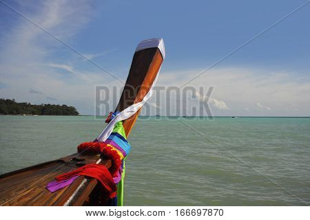 marine landscape view from long tail boat at Krabi province Koh Phi Phi island in Thailand South Asia with sea water in turquoise and emerald color under blue sky in tourism and travel destination concept