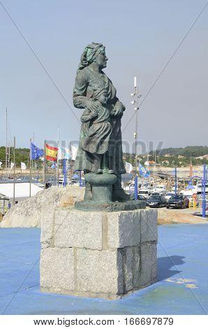 LA TOJA, SPAIN - AUGUST 8, 2016: Monument to a Galician woman next to the marina the island of La Toja Galicia Spain.