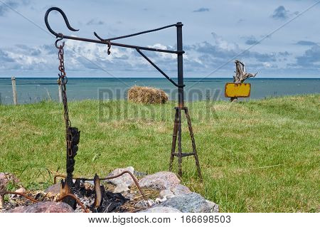 Coast resting place with a campfire cooking pots hook