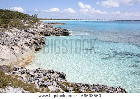 The view of rocky coast with transparent waters on uninhabited Half Moon Cay island (Bahamas).
