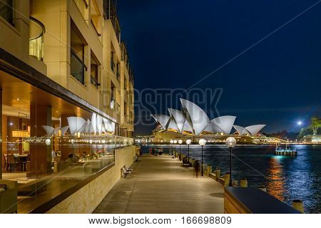 SYDNEY AUSTRALIA - OCTOBER 16 2016: Sydney Opera House reflected in the windows of the Park Hyatt Hotel at night.