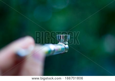 pipe for smoking medical marijuana a bunch of dry medicinal cannabis marijuana intended for smoking for medical purposes rastafaray hippi