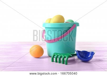 Easter eggs with pail, on white background