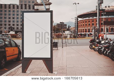 Empty mock up banner for your advertising blank billboard with copy space area for your text message or promotional content public information board in urban setting with highway taxi and mopeds