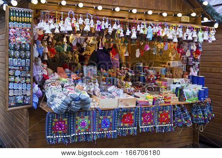 LVIV, UKRAINE - DECEMBER 11, 2016: Woman sells souvenirs on Christmas holiday market on the central square of Lviv (Market square)