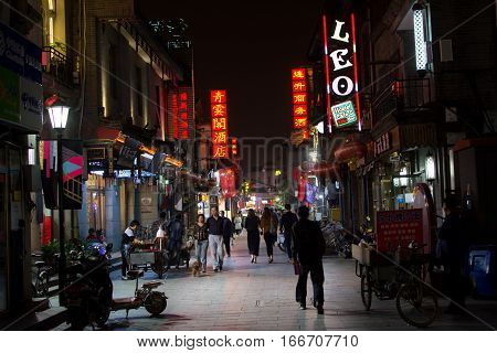 Beijing, China - September 29: Hutong Street Night View With People Walking