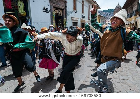 Cusco, Peru - October 7, 2016: Peruvian boys wearing traditional clothes and hats dance in a festive procession.