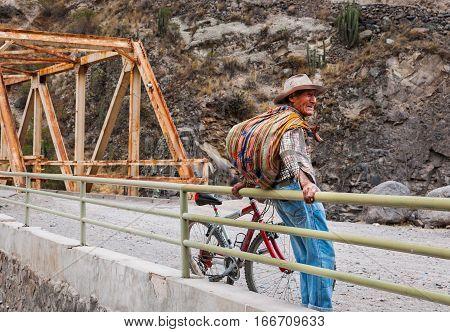 Arequipa, Peru - October 8, 2016: Native Peruvian standing on the bridge