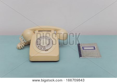 Green Table With Rotary Telephone and Address Book