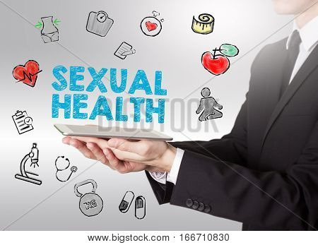 Sexual Health concept. Healty lifestyle background. Man holding a tablet computer.