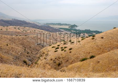 Shore of Lake Kinneret the slopes of the Golan Heights in Israel