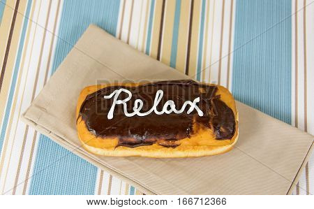 word relax in white icing on chocolate donut