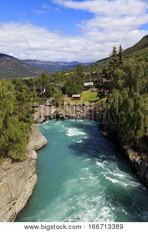 This is torrent crystal clear blue waters of one of the mountain rivers which originate in the glaciers.