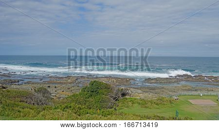 Rocky landscape on the Indian Ocean at the Garden Route in South Africa, surf on the coast in the Tsitsikamma National Park in the province of Eastern Cape, rock on land and under water