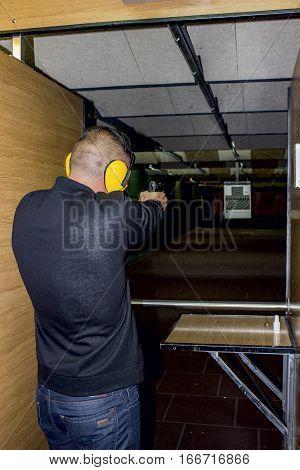 man shoots a gun training in shooting