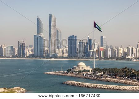 Elevated view of Abu Dhabi downtown skyline and corniche with the flag pole. United Arab Emirates Middle East