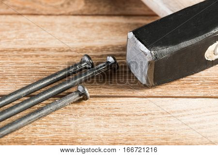 Home repair concept with hammer and nails on wooden table