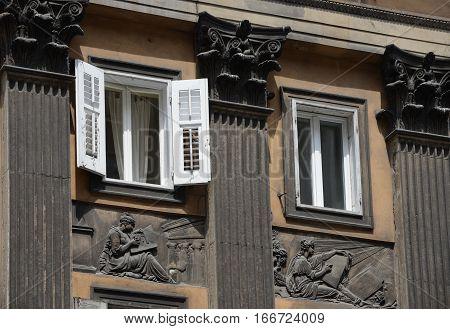 Facade with Corinthian columns reliefs and windows on Corso Italia Trieste. poster