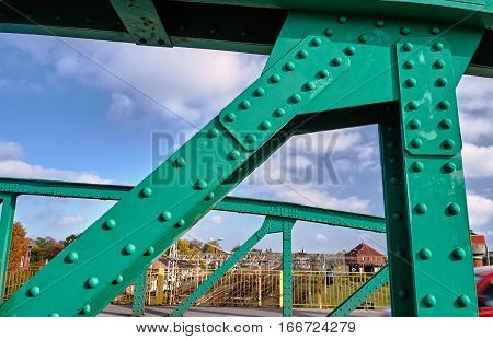 The steel construction of the road bridge over the railway tracks in Gniezno