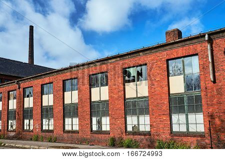Abandoned factory hall with red brick in Gniezno