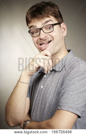 Crazy adult man make crazy faces in studio