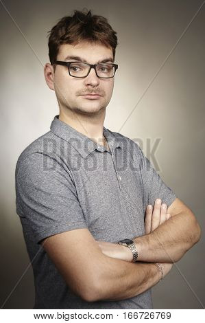 Adult man in glasses make faces in studio