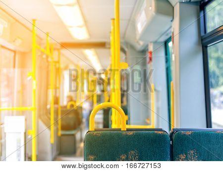 Interior of empty modern european city bus in Sweden on sunset