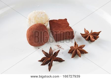 Chocolates border isolated on white background. Chocolate. Assortment of fine chocolates in white, dark, and milk chocolate. Variety of Praline Chocolate sweets