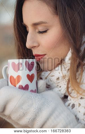 Coffee. Beautiful Girl Drinking Tea or Coffee outdoor. Woman with a cup of Hot Beverage.