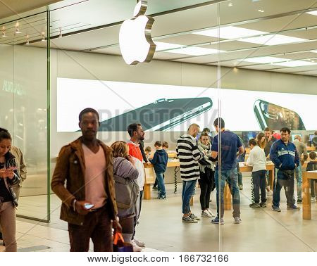 RIMINI ITALY - JANUARY 18 2017: Apple store located in a shopping center in Rimini. ITALY. Apple Inc sells computer and electronic devices by a modern global retail chain.Focus on people inside shop