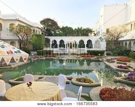 UDAIPUR INDIA - JANUARY 14 2017: Taj Lake Palace Hotel Restaurant Courtyard. One of the most recognizable residences in the world was featured in the film Octopussy.