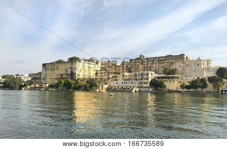 UDAIPUR INDIA - JANUARY 14 2017: City Palace. Located on Lake Pichola and built in a flamboyant style is considered the largest of its type in the state of Rajasthan.
