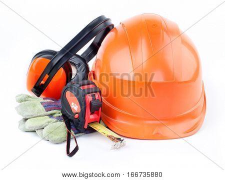 Orange plastic construction Helmet, roulette, gloves, headphones on a white background