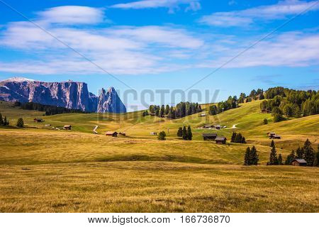 Jagged rocks around the Dolomites valley. The Alps di Siusi. Well-known international ski resort in the fall. Concept of active and ecological tourism
