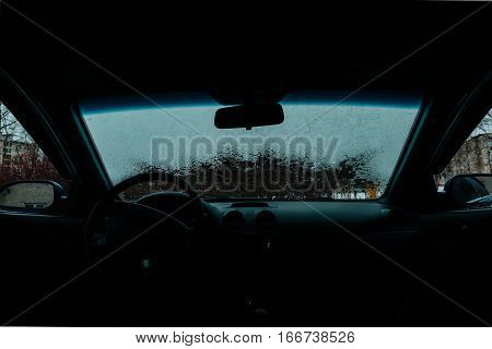 Car Windshield thawed Snow Thawing On A Windshield Of A Car view from the passenger compartment