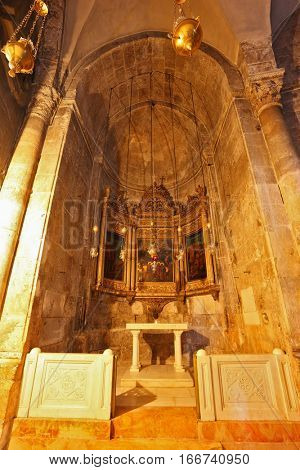 JERUSALEM, ISRAEL - MARCH 9, 2012: The  decorated the side chapel in the Cathedral of the Holy Sepulchre. Hall is made entirely of marble. Photo taken by lens Fisheye