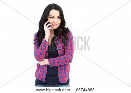 Girl In Checkered Shirt Speaking On Cellphone.