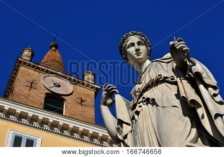 Pagan goddess statue and Christian church bell tower from People's Square in Rome
