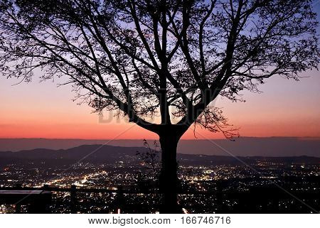 Glowing sunset over city lights. Hill above Nara. Kansai region of Japan. UNESCO World Heritage Site.