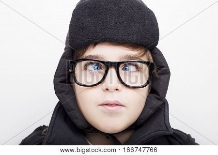 Handsome boy is wearing eyeglasses and making squint. Isolated on white background