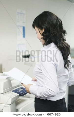 a young woman working with print in office