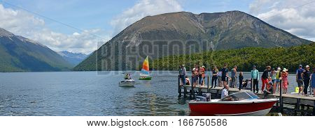 Rotoiti New Zealand - December 26 2016; People on holiday boating and swimming at Lake Rotoiti in the Nelson Lakes District.