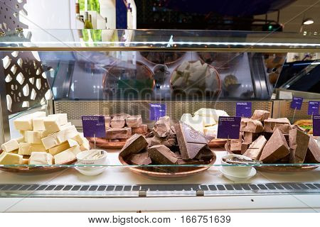 DUBAI, UAE - CIRCA NOVEMBER, 2016: chocolate at Dubai Airport. There are a lot of restaurants, bars, cafes and shops in Dubai International Airport. Almost all of them are open twenty-four hours.