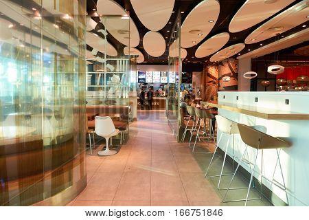 DUBAI, UAE - CIRCA NOVEMBER, 2016: McDonald's in Dubai International Airport. McDonald's is an American hamburger and fast food restaurant chain.