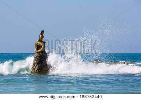 NGAPALI, MYANMAR - DECEMBER 14, 2016 : mermaid statue of Ngapali Beach near Thandwe at Rakhine state in Myanmar