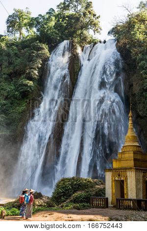 PYIN OO LWIN, MYANMAR - NOVEMBER 29, 2016 :  two young woman praying in front of Dat Taw Gyaint Waterfall Anisakan Pyin Oo Lwin Mandalay state Myanmar