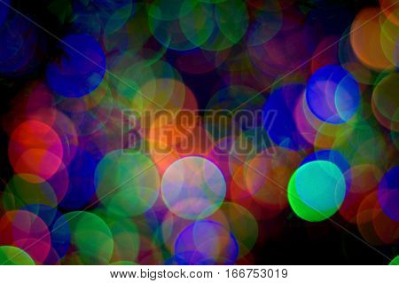 Big round Circles of multicolor red green blue on a dark black abstract bokeh effect background