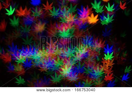 psychedelic marijuana leaves red green blue multicolored bokeh effect abstract dark black background